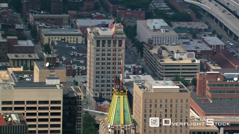 Close flight over Baltimore's Schaeffer Towers and Baltimore Trust building.