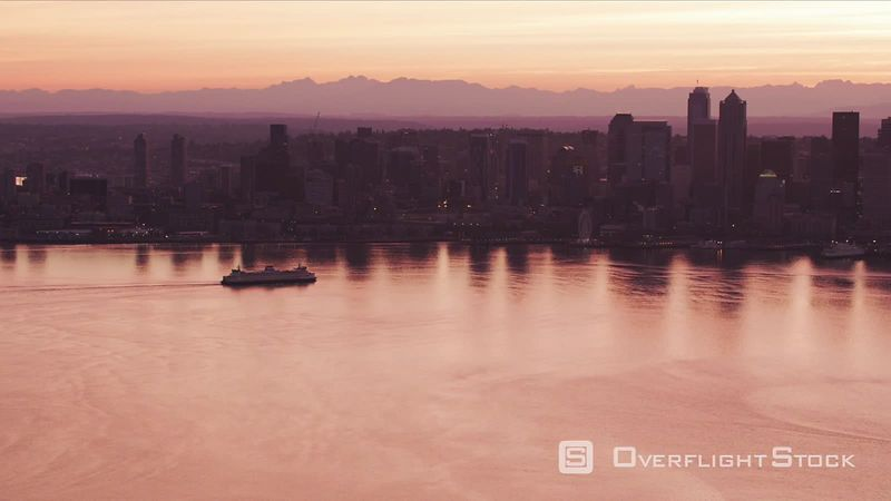 Seattle, Washington Aerial view of ferry moving towards downtown at sunrise.  Shot with Cineflex and RED EpicW Helium.