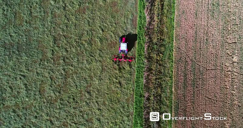 Plowing Machine, 4k Aerial View Above a Plow Tractor, Harvesting, Grass Field, Sunny Autumn Day, Uusimaa, Finland