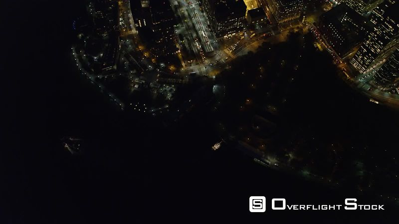 Flying over the Hudson at night to look down at Financial District in Lower Manhattan.