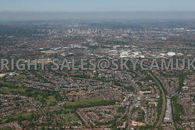 Birmnigham high level wide angle aerial photograph showing the urbanisation and looking from Acocks Green towards Birmingham city centre on the horizon