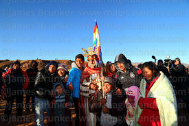 A Bolivian family have their photo taken with a man dressed as a Tiwanaku leader during Aymara New Year celebrations, Tiwanaku, Bolivia