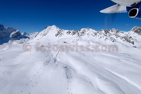 Airview of St. Moritz Corviglia and surroundings in winter.