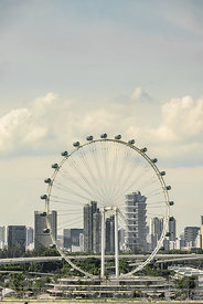 SINGAPORE CITY, SINGAPORE - OCTOBER 09, 2016:  The Singapore wheel and towerblocks close the the bay area.