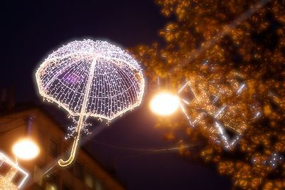 Christmas Decoration in the shape of an illuminated umbrella  in Oxford Street London