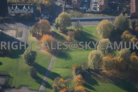 Manchester aerial photograph of a small park with autumnal coloured trees