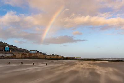 Rainbow over windblown sand on Frinton beach