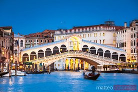 Rialto bridge and gondola, Venice, Italy