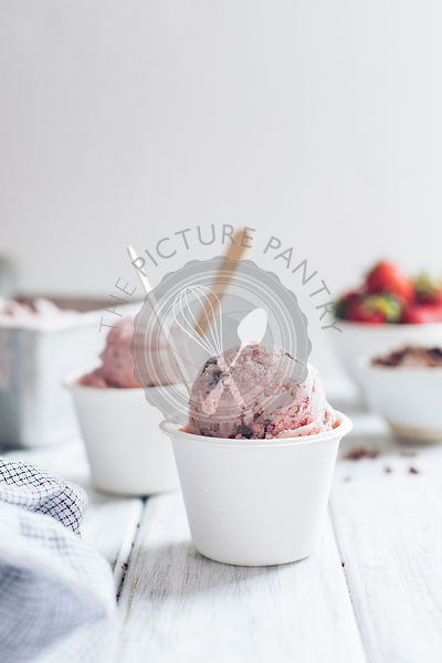 Strawberry ice cream in white cups