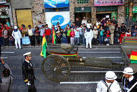 A navy officer escorts the remains of Eduardo Abaroa as they arrive in Plaza Avaroa on a gun carriage, La Paz, Bolivia