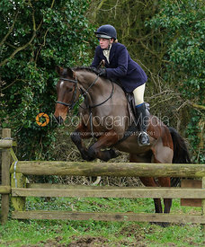 Jess Butler jumping a hunt jump near Knossington Spinney