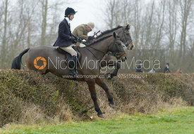Willa Newton jumping the first hedge
