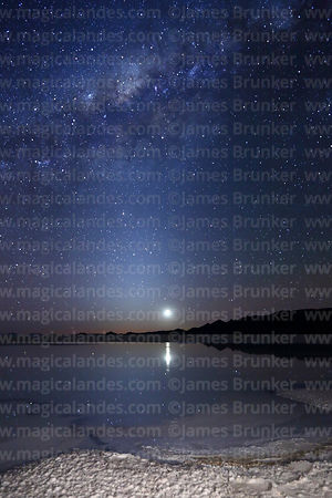 Milky Way Galactic Centre and 2 day old new moon above saline pool, Salar de Uyuni, Bolivia