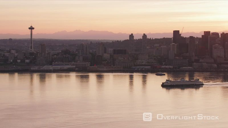 Seattle, Washington Aerial view of Seattle and ferry at sunrise.  Shot with Cineflex and RED EpicW Helium.