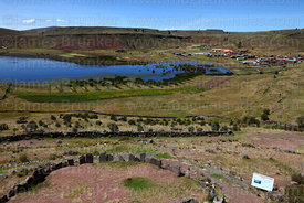 Stone circle with intihuatana, probably from Inca period, Lake Umayo in background, Sillustani, Peru