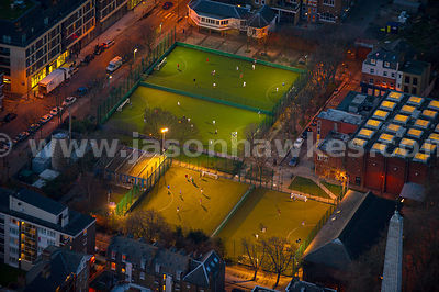 Aerial view of people playing football at night, London