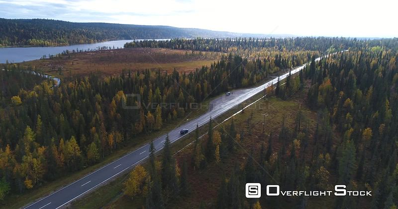 Autumn Color Road, Aerial View Following a Car Driving on a Fall Road, Between Colorful Autumn Forest and Tunturi Fjeld Mountains, on a Rainy Day, in Pallasyllas National Park, Lapland, Finland