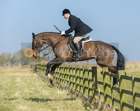 Jeremy Dale jumping a hunt jump near the meet at Goadby Marwood