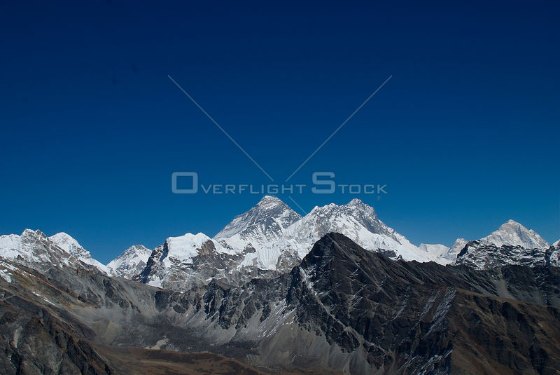 NEPAL Gokyo Peak -- Mount Everest (centre 8848m) dominates this view from Gokyo Ri. Beside it on the right is Mount Nuptse (7861m) and Mount Lhotse (8414m) and on the far right, Mount Makalu (8475m)