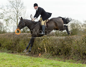 Ed Winterton jumping a hedge on Graham Smith's