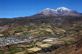 Aerial view of Putre , Nevados de Putre / Taapaca volcano in background , Region XV , Chile