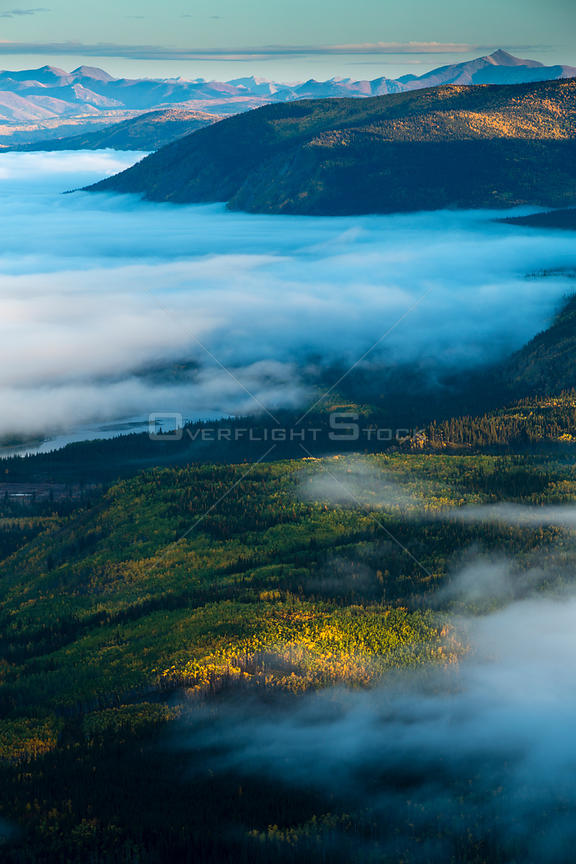Mist filled valley of the Yukon River at dawn, near Dawson City, Dome Hill, Yukon Territories, Canada, September 2013.