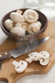 Mushrooms on chopping board