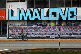 Cyclist and Lima Love slogan on wall, Miraflores, Lima, Peru