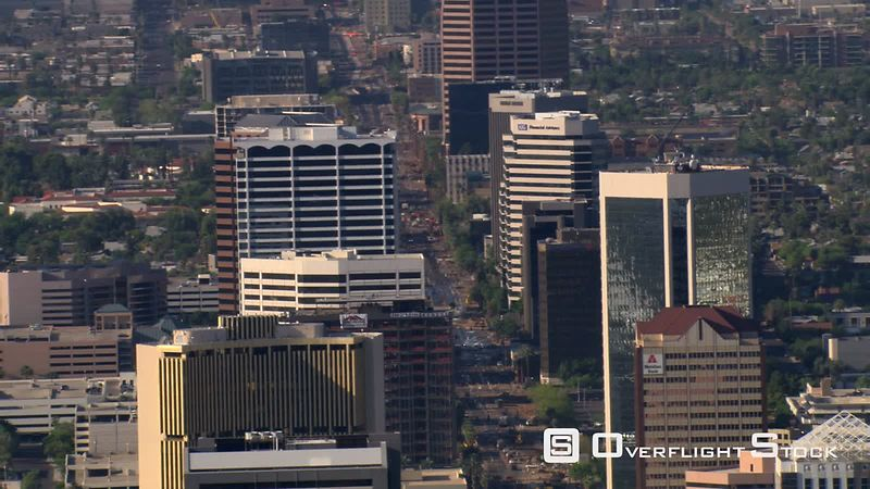 Flight past downtown Phoenix with wide view of layered skyscrapers.