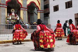 Cholita dancers paying respect to Virgen de la Candelaria in entrance of her Sanctuary, Puno, Peru