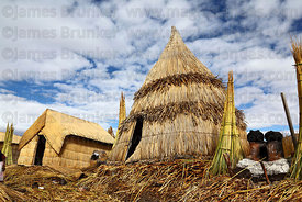Reed houses on Uros floating reed islands , Lake Titicaca , Peru