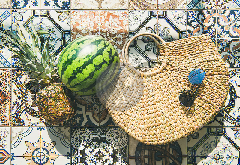 Summer lifestyle background with fruits and straw bag, horizontal composition
