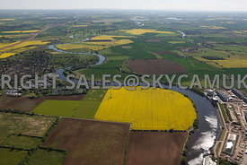 Newark on Trent aerial photograph of the river Trent meandering through the countryside with fields of yellow Rape seed in flower