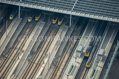 Aerial view of London, close up of railway lines and platforms.