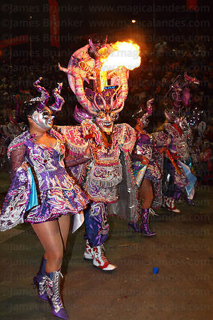 The famous Urus Diablada dance group performing at night with pyrotechnics , Oruro Carnival , Bolivia