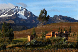 Rustic adobe church and Mt Chicon , near Chinchero, Cusco region, Peru