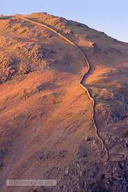 Stone wall on mountainside, Lake District, Cumbria, England.