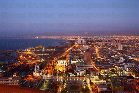Aerial view of city and port from El Morro headland at sunset, Arica, Region XV, Chile