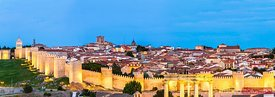 Panoramic view of the old walled city at dusk, Avila, Spain
