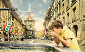 Boy drinks water out of Zahringer Fountain; Bern, Switzerland