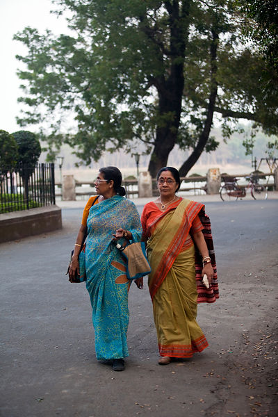India - Chandannagar - Two women walk arm in arm through Chandannagar