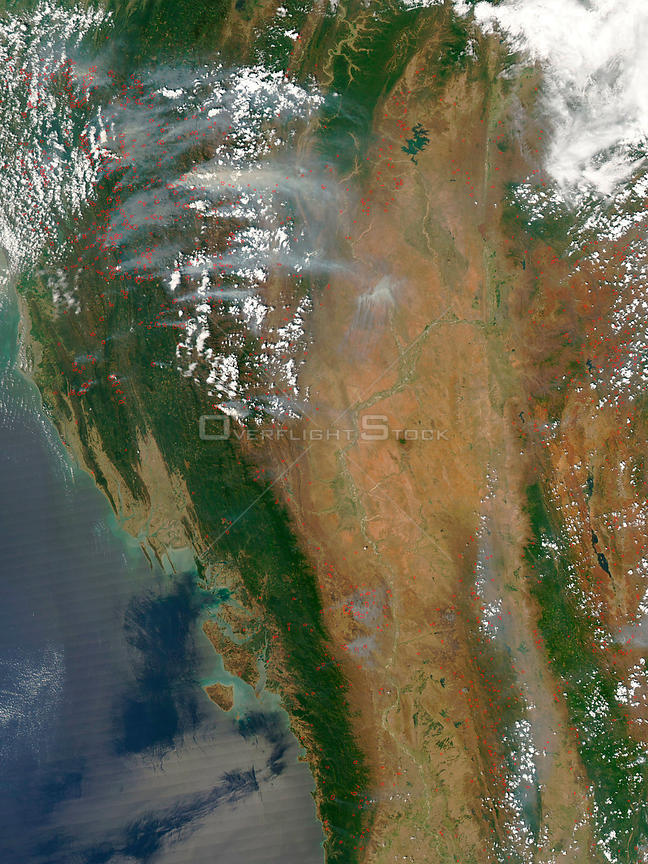 EARTH Bangladesh / Myanmar -- 21 Mar 2005 -- Scores of fires clog the sky above Bangladesh, east India, and Myanmar with thick white clouds of smoke.