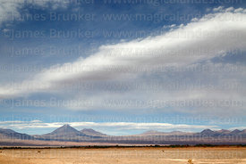 View across desert near San Pedro de Atacama to Licancabur (L) and Juriques (R) volcanos, Region II, Chile