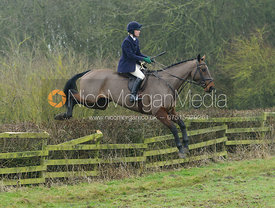 Chloe Shann jumping a hedge at Town Park Farm