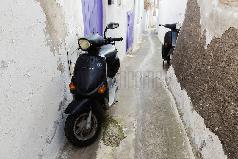 Scooters Parked in a Narrow Alley