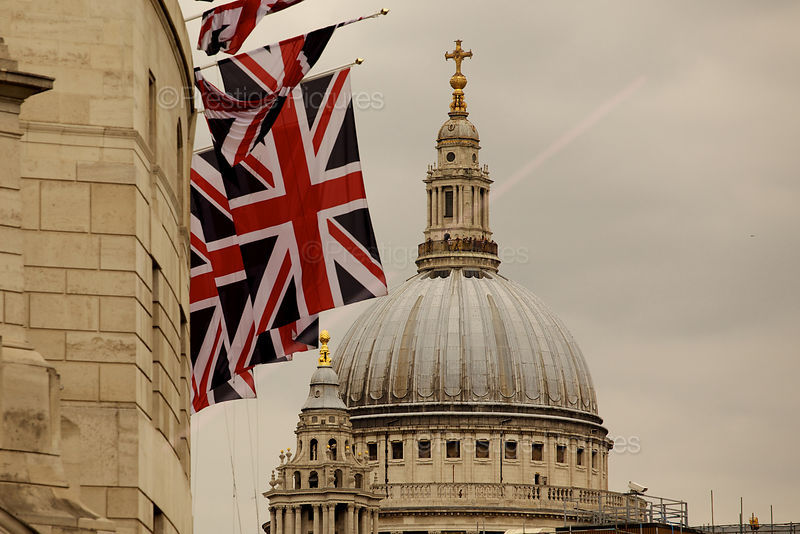 The Dome of St Pauls Cathedral and many Union Jack Flags