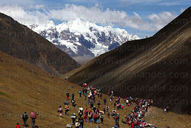 Pilgrims descending to village of Mawayani after Qoyllur Riti festival, Peru