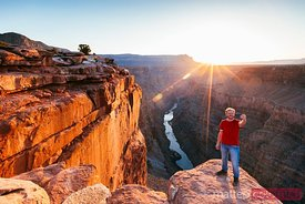 Man taking a selfie at Grand Canyon at sunrise, USA