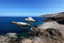 Playa Blanca beach and guano covered islands near Pisagua , Region I , Chile