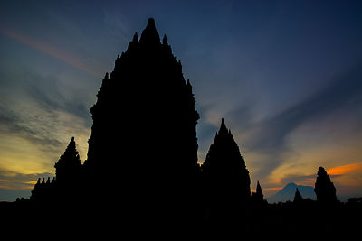 Prambanan Temple at Sunset with Mt. Merapi looming in the background.  Near Yogyakarta, Indonesia.
